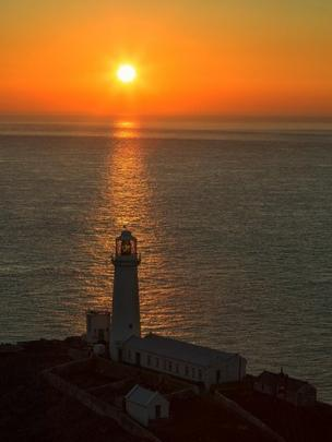 Another sunset photo - of South Stack Lighthouse on Anglesey - was taken by Kev Lewis from the island during the recent fine weather