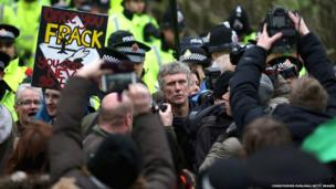 Happy Mondays star Bez (centre) joins protesters blocking lorries trying to enter the Barton Moss