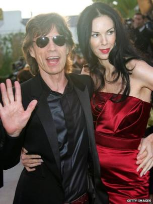 Mick Jagger and L'Wren Scott arrive at the Vanity Fair Oscar Party in 2006