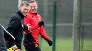 Manchester United manager David Moyes and player Wayne Rooney during a training session at the AON Training Complex, Manchester