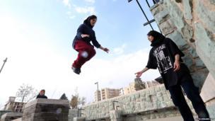Iranian women practice parkour in Tehran's Tavalod Park
