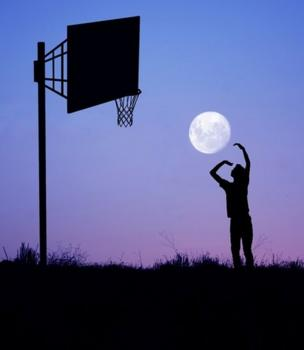 The silhouette of a man against the backdrop of the full moon in a purple sky. The man appears to be playing basketball with the Moon.