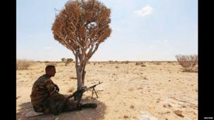 A Somali government soldier sitting under a tree, Somalia - Wednesday 19 March 2014