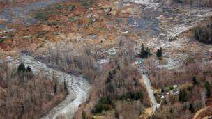 An aerial image of the area shows the extent of the damage
