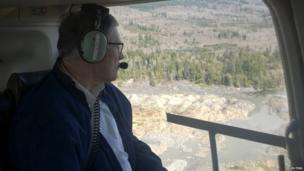 Washington Governor Jay Inslee surveys the damage from a helicopter