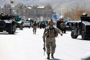 Afghan security officers arrive at the scene of an explosion in Kabul