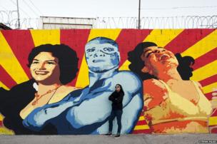 Ana Maria Cruz alias Ana Formismo in front of her mural in Ciudad Juarez, Chihuahua, Mexico
