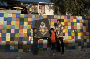Efren De La Cruz, painter, in front of his apartment building in Mexicali, Baja California, Mexico