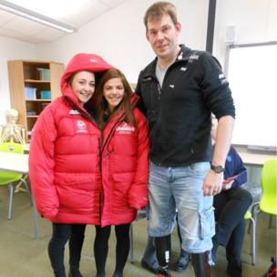 Two School Reporters with Duncan Slater. The girls model the jacket he wore to the South Pole.