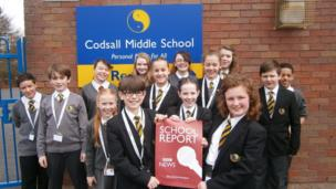 Pupils at Codsall Middle School in Staffordshire hold the School Report poster.