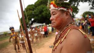 Chief of Aishalton village Tashao Bernard Conrad prepares to receive the Queen's Baton in Guyana.