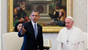 President Barack Obama gestures while alongside Pope Francis at the Vatican