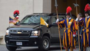 The car of US President Barack Obama enters the Vatican prior a private audience with Pope Francis, flanked by members of the Swiss Guard