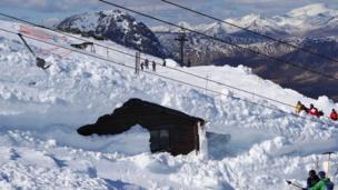Ski patrol shed in snow
