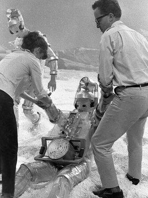 director, Derek Martinus, and his Production Assistant, Edwina Verner, give a helping hand to one of the Cybermen filming The Tenth Planet