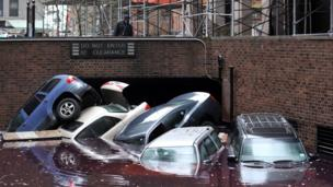 Cars piled up in New York in the aftermath of Hurricane Sandy