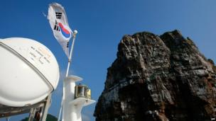 The South Korean national flag flies from a boat on Baengnyeong Island on 15 June, 2010