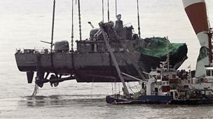 A giant floating crane lifts the stern of a South Korean warship to place it on a barge on 15 April, 2010