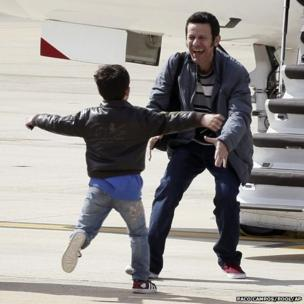 Spanish reporter Javier Espinosa reacts as his son Yerai runs towards him