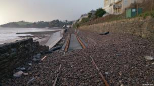 Dawlish railway line covered in pebbles