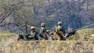 South Korean army soldiers take a position during an exercise in Yeoncheon, near the border with North Korea