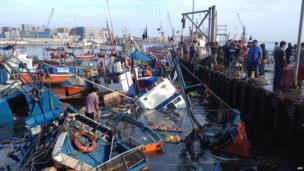 Partially sunken fishing boats in Iquique