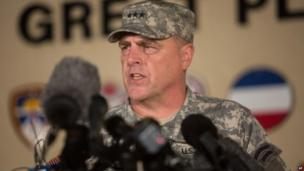 Lt Gen Mark Milley speaks to reporters outside Fort Hood military base following the shooting there on 2 April 2014