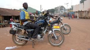 Motorbike taxi riders on 1 April 2014 in Gueckedou, Guinea