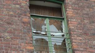 A broken window on the property
