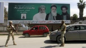 Afghan police officers patrol a checkpoint as part of increased security measures ahead of the country's election in Jalalabad on 3 April 2014.