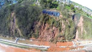 Parts of the railway route runs next to a cliff face, and there were concerns that a rain-soaked cliff face near Teignmouth was at risk of collapsing onto the track.