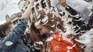 A woman is showered in feathers