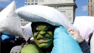 Man dressed as The Incredible Hulk hit by a pillow