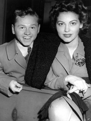 Mickey Rooney and wife, Ava Gardner, arrive in New York in January 1942, en route to Boston where Rooney is to appear at a Red Cross benefit