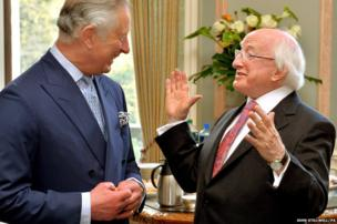 The President of Ireland Michael D Higgins talks with the Prince Charles
