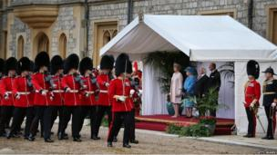 The Queen and Michael D Higgins watching soldiers march past