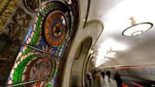 Below ground in the Russian capital, metro passengers wait for a train at Moscow's Novoslobodskaya station, 10 April 2014