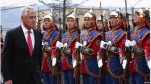 The US Secretary of Defense Chuck Hagel reviews the honour guard during a welcome ceremony at the Mongolian Ministry of Defence in Ulaanbaatar on 10 April 2014