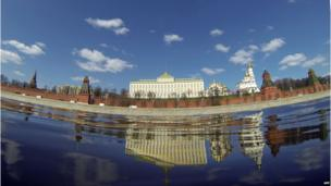 The Kremlin, reflected in the Moskva river in central Moscow on a clear spring day, 10 April 2014