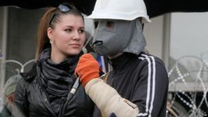 A pro-Russia activist wearing a hand-made mask speaks to supporters during a rally in front of the regional administration building in Donetsk, Ukraine, on 9 April 2014.