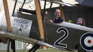 Prince William, Duke of Cambridge sits in the cockpit of a WW1 biplane as director Peter Jackson films him during a visit to Omaka Aviation Heritage Centre in Blenheim, New Zealand, 10 April