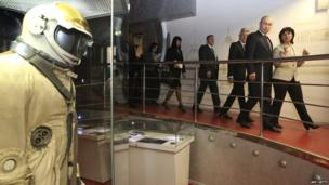Russia's President Vladimir Putin visits Moscow's Cosmonautics Memorial Museum, and looks at an old cosmonaut suit
