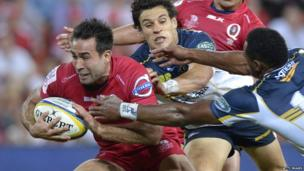 Rod Davies of the Reds breaks away from Brumbies' defence during the teams' round nine Super Rugby match on 11 April in Brisbane, Australia.