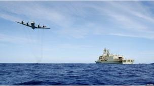 A Royal Australian Air Force AP-3C Orion conducts a low level fly-by before dropping supplies to Australian Navy ship HMAS Toowoomba as they continue to search for missing Malaysian Airlines flight MH370.