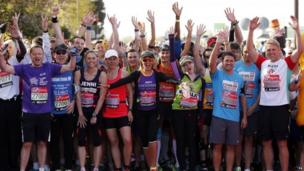 Celebrity runners gather at the start before the Virgin Money London Marathon,