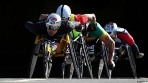 Marcel Hug of Switzerland leads David Weir of Great Britain through Blackfriars tunnel during the London Marathon
