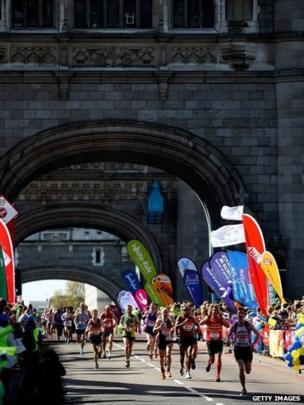 Runners make their way over Tower Bridge