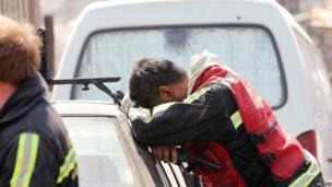 A rescue worker rests in Valparaiso, on April 13, 2014.