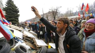 Pro-Russian protesters attend a rally in front of the seized office of the SBU state security service in Luhansk, eastern Ukraine on 14 April 2014