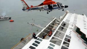 A South Korean Coast Guard helicopter winches passengers off of the sinking ferry - 16 April 2014